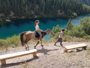 Horse riding at the Kolsai Lakes, Kazakhstan
